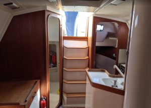 Bathroom to left, aft cabin and galley to the right