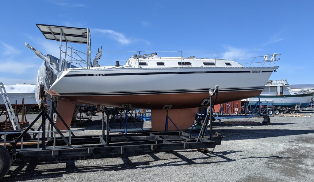 CS34 sailboat in boat yard on cradle